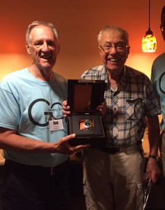 Hendrik Bütter (right) receives a Scheyden Steam Gauge Timepiece from GTO host Joe Jones at the 2015 Gateway to Osh Fly-In.  The GTO Fly-in is held