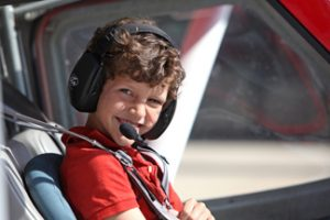 Calvin Burdick, 9, of Oshkosh, Wisconsin is ready for his Young Eagle flight—his first time in small aircraft. Oshkosh, WI, Wittman Regional Airport International Young Eagles Day Chapter 252, June 14, 2014 Brady Lane/EAA
